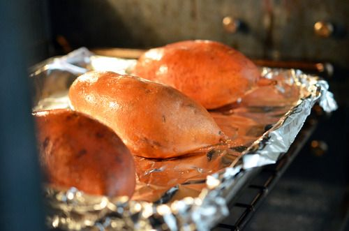 The best way to bake sweet potatoes/yams is to lightly coat them in coconut oil, pierce 'em multiple times with a knife, and stick them in a 400°F oven for 45 minutes to an hour. From Nom Nom Paleo