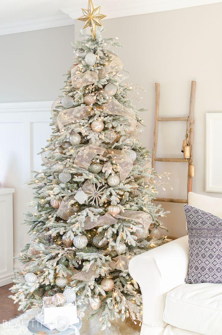 A Snowy Flocked Christmas Tree Christmas Flocked Snowy Tree Christmas Tree Inspiration Gold Christmas Tree Christmas Tree Themes