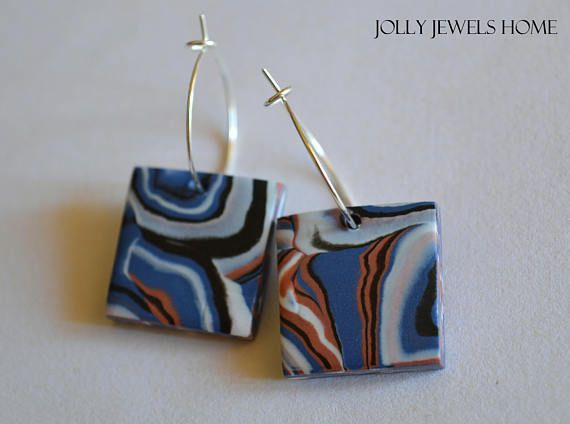 These marble blue, copper, white & black summer earrings are handmade from polymer clay (FIMO), which was handshaped into square flat beads, combined with silver tone hoop earwires. Designed in a nice geometric style, one of a kind, handcrafted and handshaped, therefore, you will never find a second one like this! Wear unique - be unique! For everyday style, a gift or any special occasion...  For a nice glossiness and protection, every piece is finished with semi-gloss varnish (FIMO). Eac...