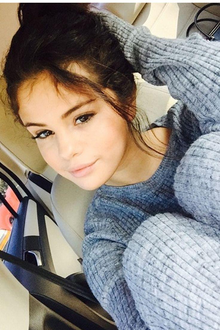 Selena Gomez takes a selfie in a car Nov. 10, 2014.   - MarieClaire.com