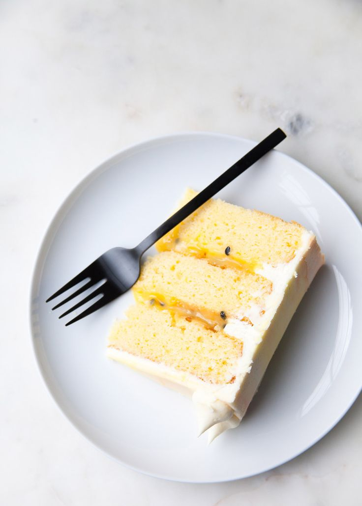 Vanilla coconut cake with passion fruit curd and cream cheese frosting.