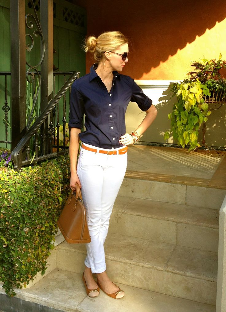 navy shirt, white jeans w/ tan shoes, belt, bag, classic styling