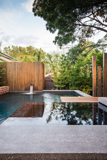 A rear water feature adds more interest to the pool area and conceals pool equipment. It's made of rough-sawn silver ash and finished the sa...