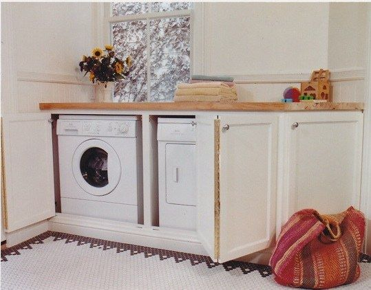 washer and dryer with counter and their hidden...perfect to put in the master for easier washing!