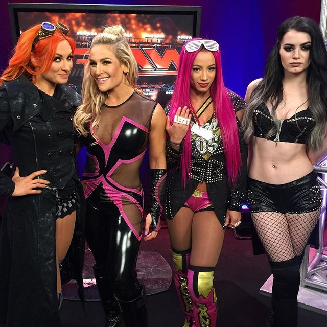 #WWE's @daniellemoinet, @trinity_fatu and @charlottewwe take on @realpaigewwe, @natbynature, @beckylynchwwe and @sashabankswwe. #RAW