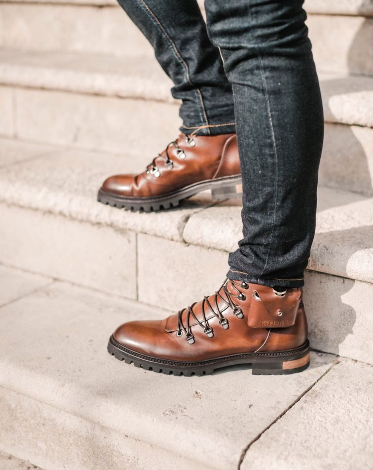 Oliver Sweeney X Talisker hiking boots featuring hipflask. Shot by Charlie Irons