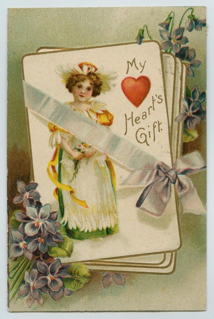 """Valentine's Day postcard addressed to Mamie Collins in Waco, Texas with an illustration of a girl dressed in a flowery outfit and the caption """"My Heart's Gift"""". Dated February 13, 1909. Photo courtesy of the Private Collection of Margay Welch."""