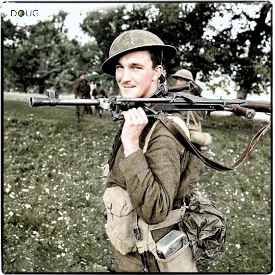Private D.B. MacDonald, Royal Canadian Regiment, carrying a Bren gun. Campobasso, Italy. October 1943, (Canada at War)