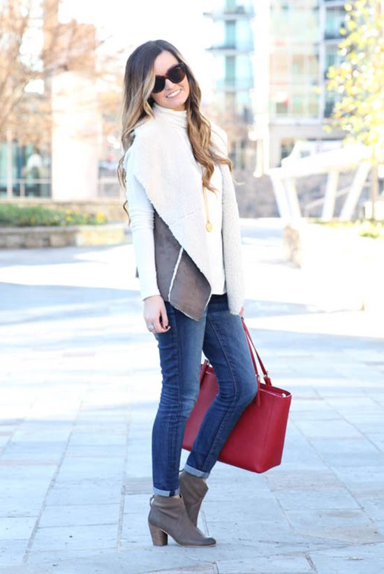 fall / winter - street style - street chic style - fall outfits - winter outfits - casual outfits - brown shearling vest + white turtleneck top + skinny jeans + brown booties + red handbag + brown sunglasses