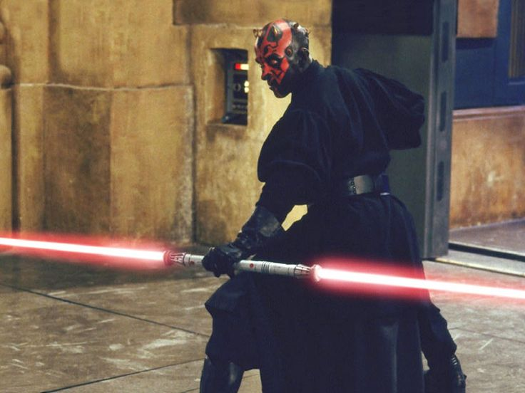 Darth Maul is the main antagonist of Star Wars Episode I: The Phantom Menace, portrayed by martial artist Ray Park. Maul serves as the apprentice of Darth Sidious, a mysterious Sith Lord who is manipulating galactic events from behind the scenes. Wielding a double-bladed lightsaber and trained as a master of lightsaber combat, Maul also serves as a personal assassin for Darth Sidious, having been sent to eliminate Obi-Wan Kenobi and Qui-Gon Jinn.