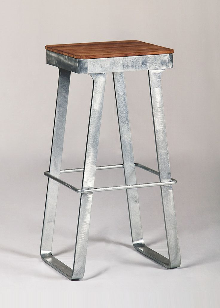 TheLuxe Bar Stool is made of steel with a slatted teakwood seat. Usable outdoors.