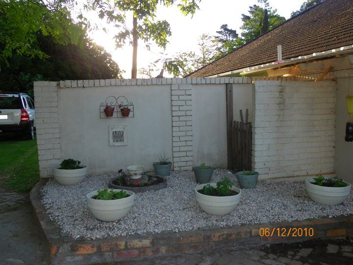 Potted Gravel Garden at back entrance of Farm house - now in state of chaos - to be restored in July 2014