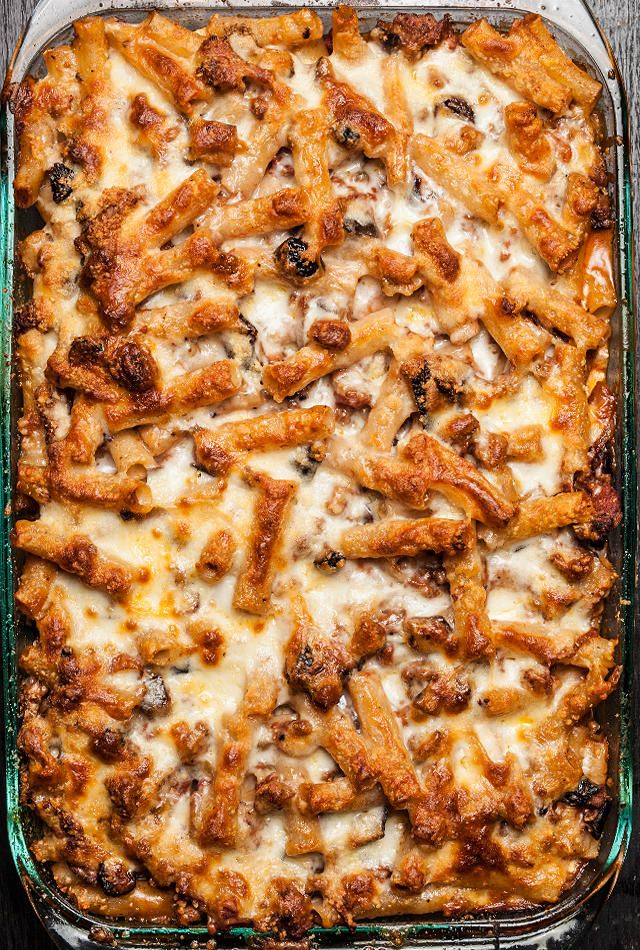 A classic baked ziti recipe, with Italian sausage, eggplant, ricotta, mozzarella, and Parmesan cheeses.