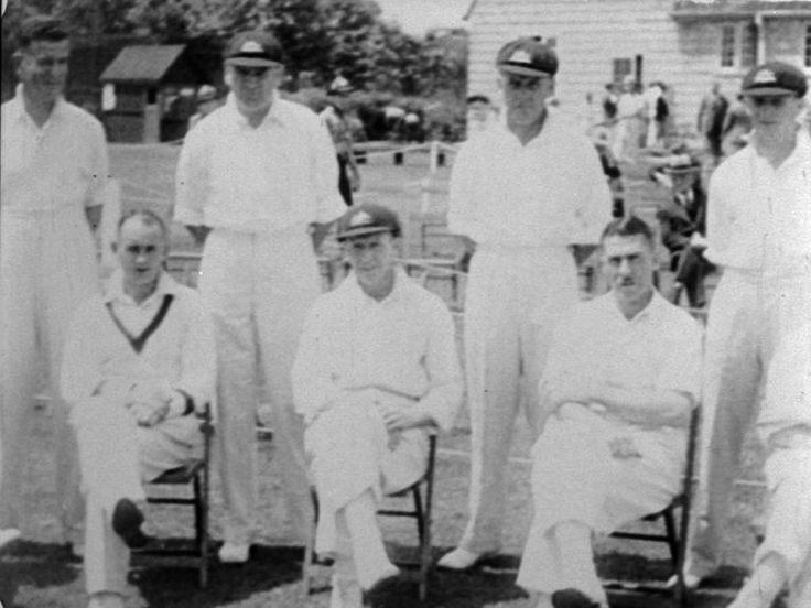 'The Australians In Toronto' Don Bradman relaxing as the OMPB cameras film the team gathered together at the Toronto Cricket Club. To the right of Bradman is former Australian Test wicketkeeper Hanson 'Sammy' Carter. Carter would permanently lose his sight in one eye following an on-field incident later in this tour (NFSA title 486807)