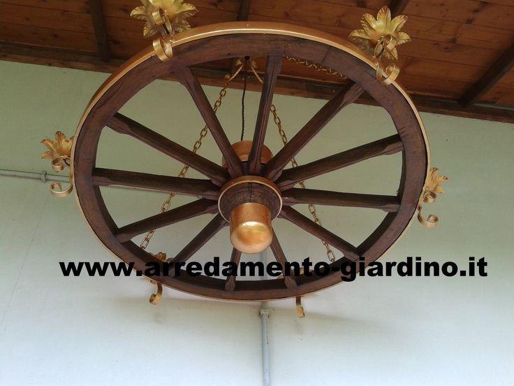 Lampadario a ruota di carro a sei lampade di diametro 120 cm. Per prezzo ed altri miei lavori visitate il mio sito: www.arredamento-giardino.it
