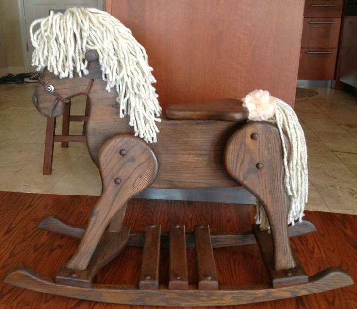 Refinished rocking horse. We had one of these. All the kids loved it.