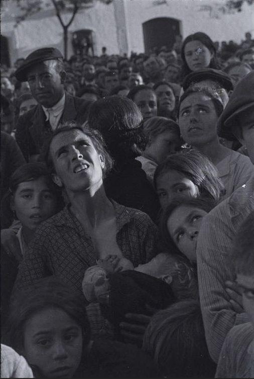 Robert Capa. Mother Nursing Child While Listening to Revolutionary Speaker, Near Badajoz, Extremadura, Spain, 1936