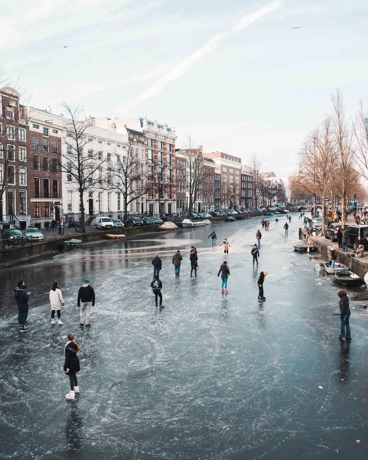 Frozen Canals In Amsterdam The Netherlands Find Us Lost Amsterdam Travel Netherlands Travel Amsterdam Photography