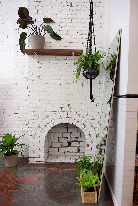 Handsom, Melbourne   Concrete Floors, Painted Bricks and Indoor Plants / exterior idea? ..painted brick?
