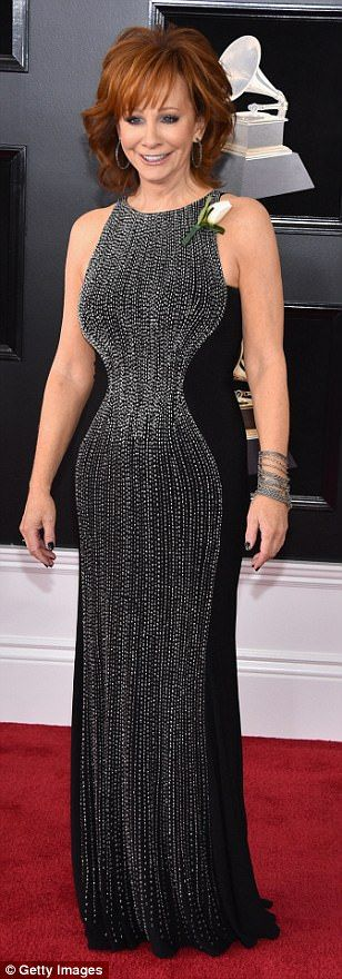 Reba McEntire:  JOVANI (gown),  Brett Freedman.com (styling)  | 60th Annual GRAMMY Awards at Madison Square Garden on Jan 28, 2018 in New York City | All in the details: Coco Austin, Reba McEntire and Kelly Clarkson  also chose black gowns,...