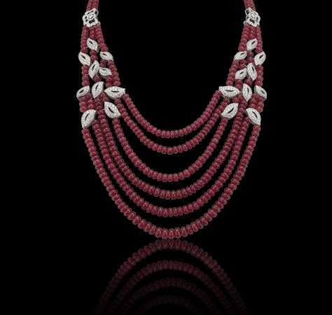Tudor Rose ruby and white diamond leaf festoon necklace, created in 18ct white gold. Matching earrings available. Also in emerald and sapphire.