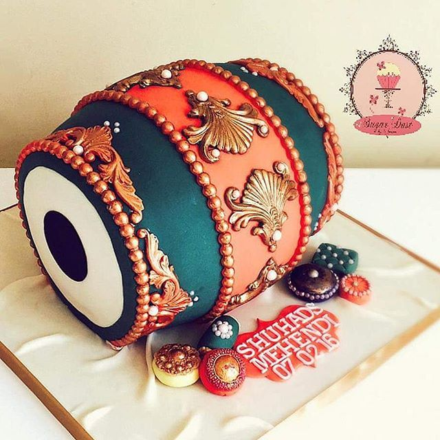 How AMAZING is this Dhol cake from Sugardust by Amina in the UK! Love love love it!!! #indianweddingcakes #mehndicakes #indianweddings #mehndiparty