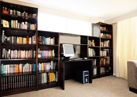 Lundia Image:Floor to ceiling Static Shelving system for a home library.
