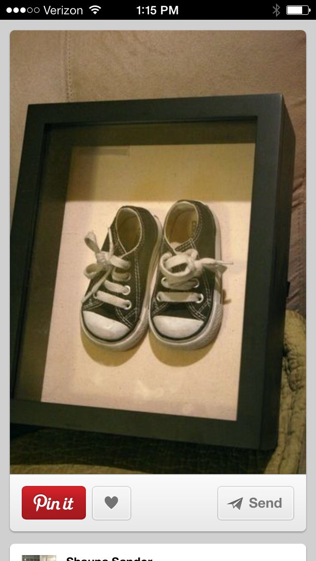 Put their first pair of shoes in a shadow box. Use  velcro on the backs to secure them.