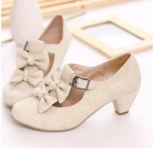 "Like these! White low heels with buckles and bows. •|•The double bows may be a bit of overkill in the ""sweetness, cutsey"" department, and if so, perhaps one or both of them are removable?•