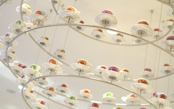 Custom chandelier with hand painted tea cups from renowned artists.