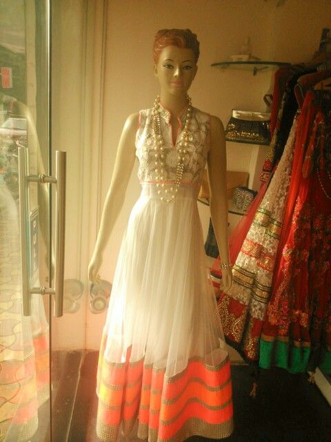 Creamy white anarkali with wool work on top and neon orange borders exclusively for Jorss by Avesh Dadlani!
