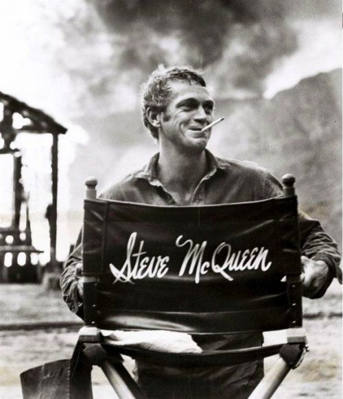 The explosion (volcano?) in the background seals this great portrait of Steve McQueen.