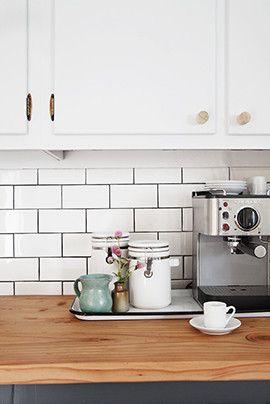 Midcentury Minimalist Rustic Scandinavian Kitchen: An espresso machine sits atop butcher block counters..