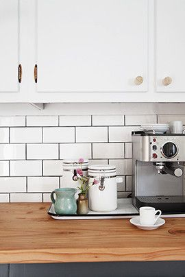 Midcentury Minimalist Rustic Scandinavian Kitchen: An espresso machine sits atop butcher block counters..
