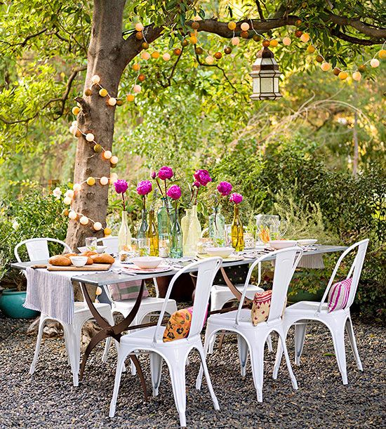 Outdoor lights remain a perennial favorite for outdoor spaces, and there's good reason: They're celebratory and fun, with just enough sparkle to keep the light from being distracting. Inventive backyard options offer pretty colors and shapes; use them to wrap a tree, or drape them down a table for a twinkling centerpiece./