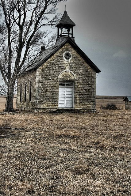 Old school house off highway 50 on the way to Elmdale, Kansas. The words in the arch are District 34, 1896. Photo taken by Derek Pinkston on March 2, 2008. Flickr.