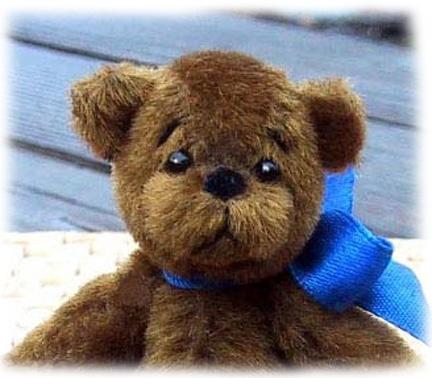 Java - jointed mini bear made of coffee-dyed long pile upholstery velvet.