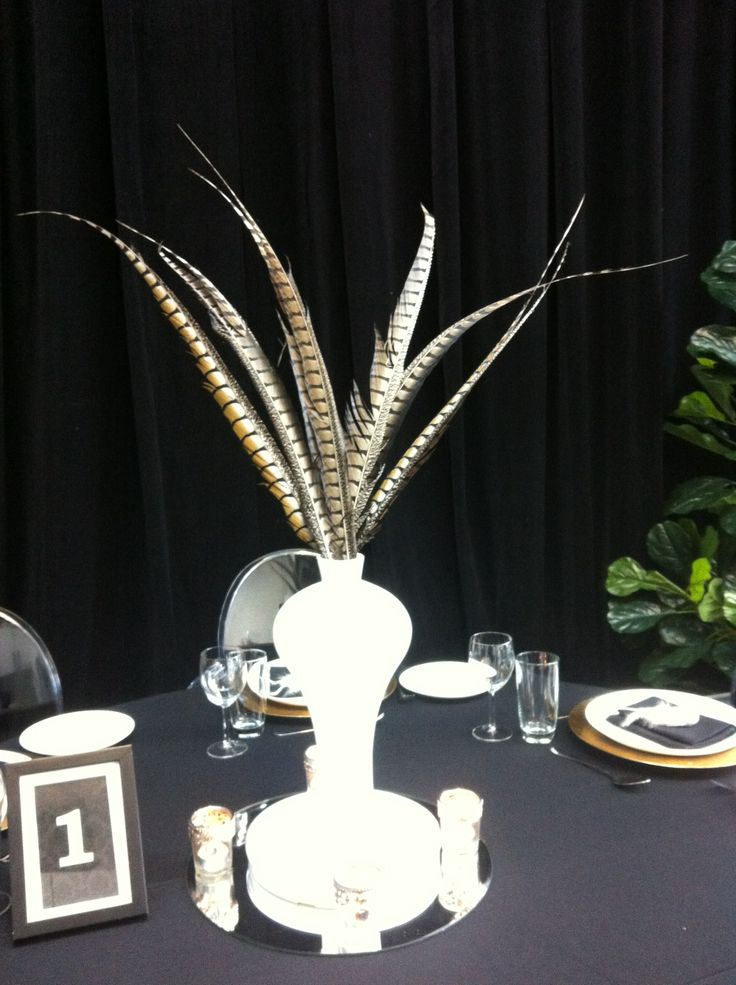 White vase with Pheasant Feathers