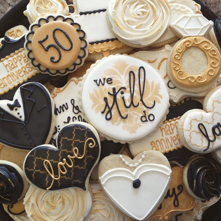 50th Wedding Anniversary cookies - For all your Golden Anniversary cake decorating supplies, please visit http://www.craftcompany.co.uk/occasions/anniversary/golden-wedding-anniversary.html