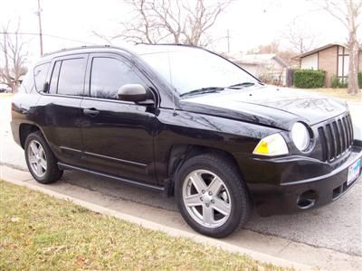 I have an '08 Jeep Compass that I bought slightly used.  It is 2 wheel drive, and it has the 4 cylinder engine although I don't know what size it is.