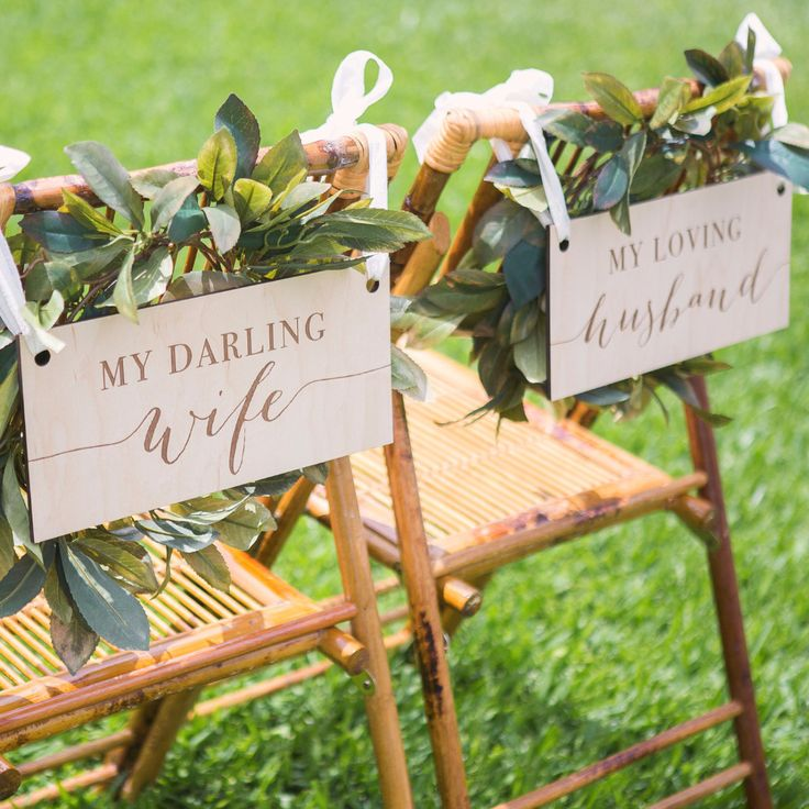 "These chair signs are engraved in rustic wood to say ""My Darling Wife"" and ""My Loving Husband"" for hanging on the chairs at the wedding sweetheart table for the bride and groom. Ivory or white ribbon"