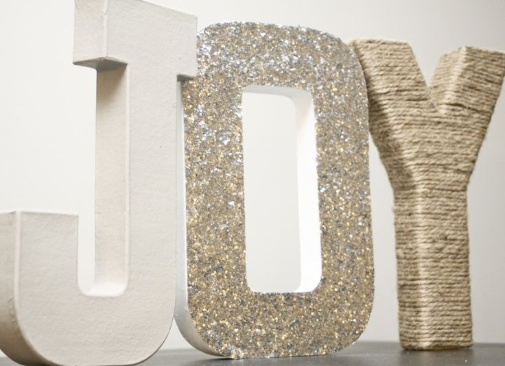Wrapped paper mache letters - I realize this is a Christmas idea page, BUT I think this is a simple decor idea for a table display that you can use your initials and add some fun other decorative things to them.
