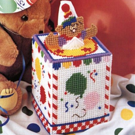 "Topped with a playful little bear and trimmed with gaily colored balloons, our tissue box cover will make a cute accent for a child's room. The design is stitched using worsted weight yarn and 7 mesh plastic canvas. <p><strong>Number of Designs:</strong> 1 tissue box cover </p><p><strong>Approximate Design </p><p><strong>Size:</strong></strong> 4-3/4""w x 9-1/4""h x 4-3/4""d (fits a 4-1/4""w x 5-1/4""h x 4-1/4""d boutique tissue box)"