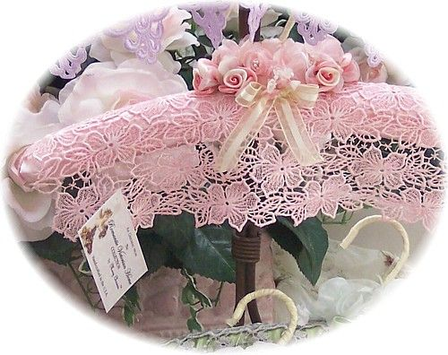 Idea for gift - pretty padded clothes hanger. Nice way to re-use old hangers, wrap batting round, cover with fabric then lace and handmade ribbon flowers.