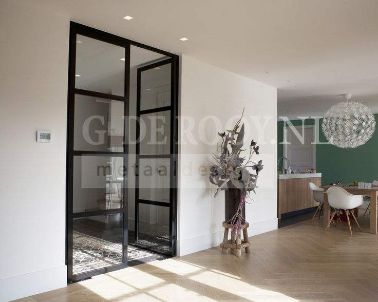 steel glass doors between old cement tiles and fishbone wooden floors