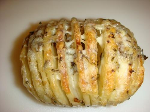 baked cheesy sliced potato