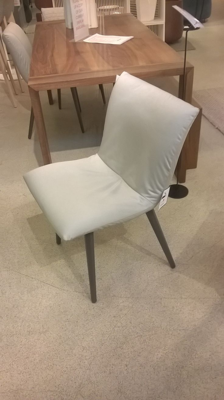 pair of Calin dining chairs in 'rasone' pearl-grey cotton with grey stained wood…
