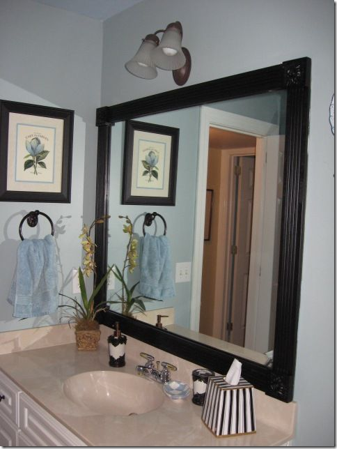Frame those boring mirrors with wood and corner blocks. Inexpensive and easy with a hot glue gun! Complete how-to!