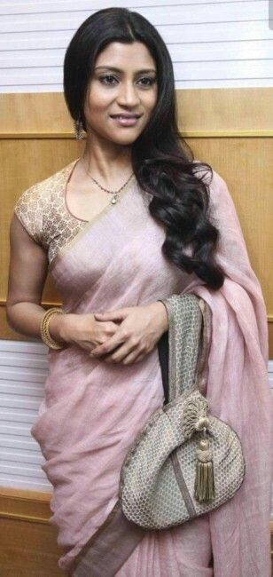 Love the subtle shade of the linen saree and also the neckline of the blouse.