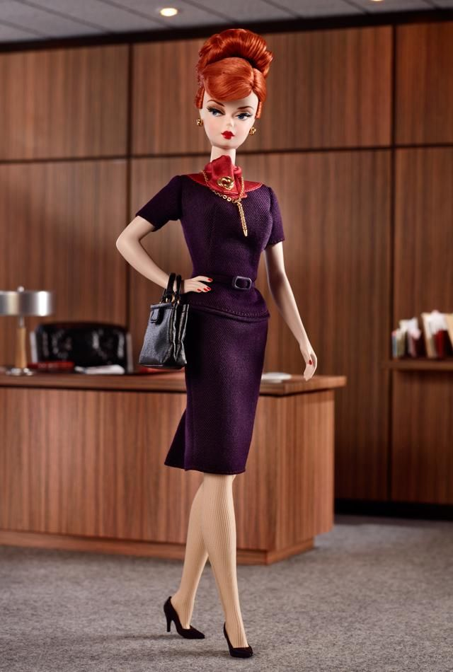 Mad Men Joan Holloway Barbie.  Love the red hair and purple dress!